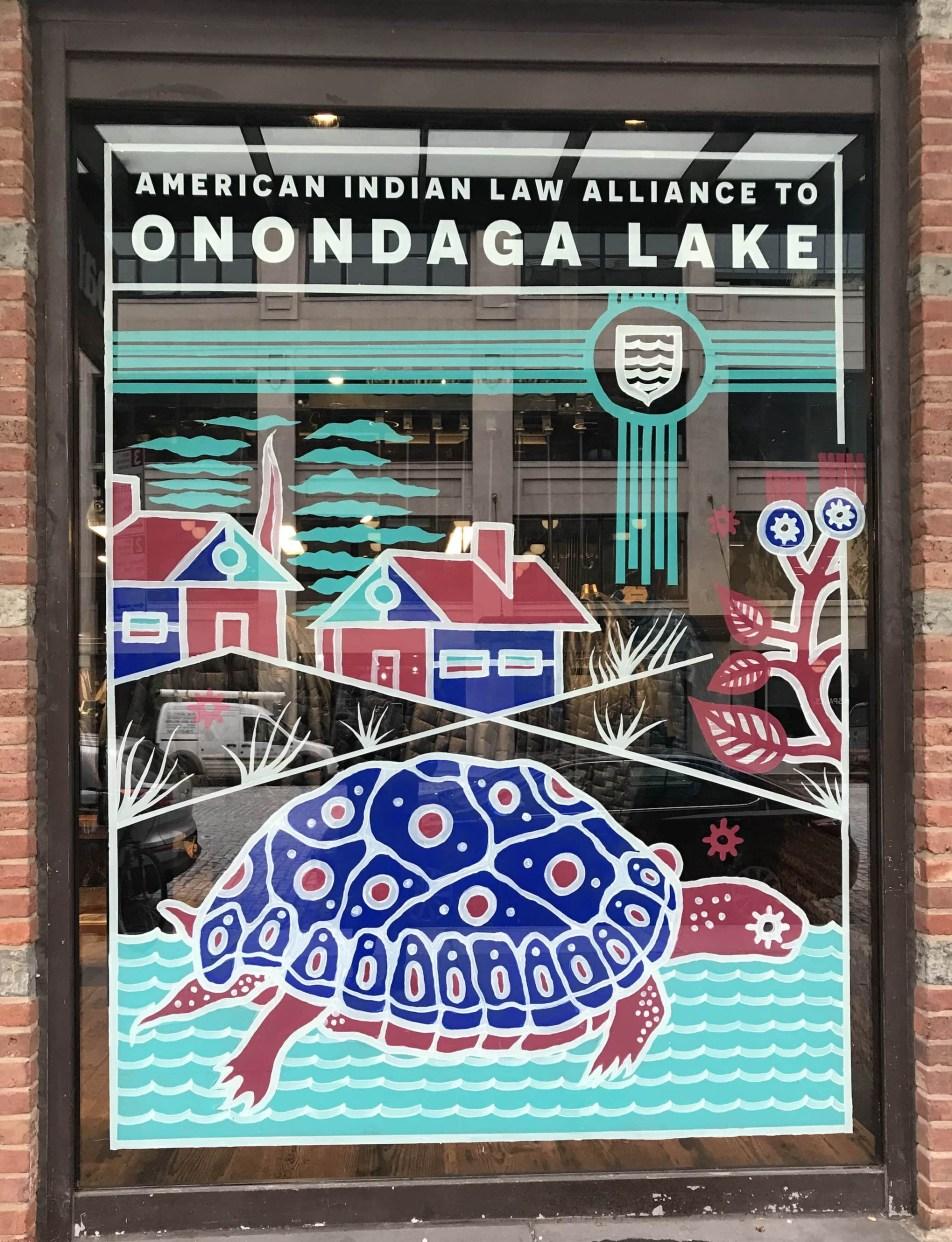 Patagonia window art in support of Onondaga Lake