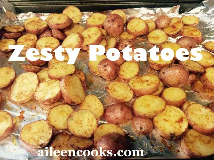Roasted red potatoes recipe all golden brown on a foil-lined cookie sheet.