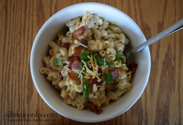 Instant Pot Loaded Macaroni and Cheese. A kid-friendly pressure cooker 30 minute meal. Loaded with bacon, cheese, and green onions. I dare you not to have seconds! recipe from aileencooks.com