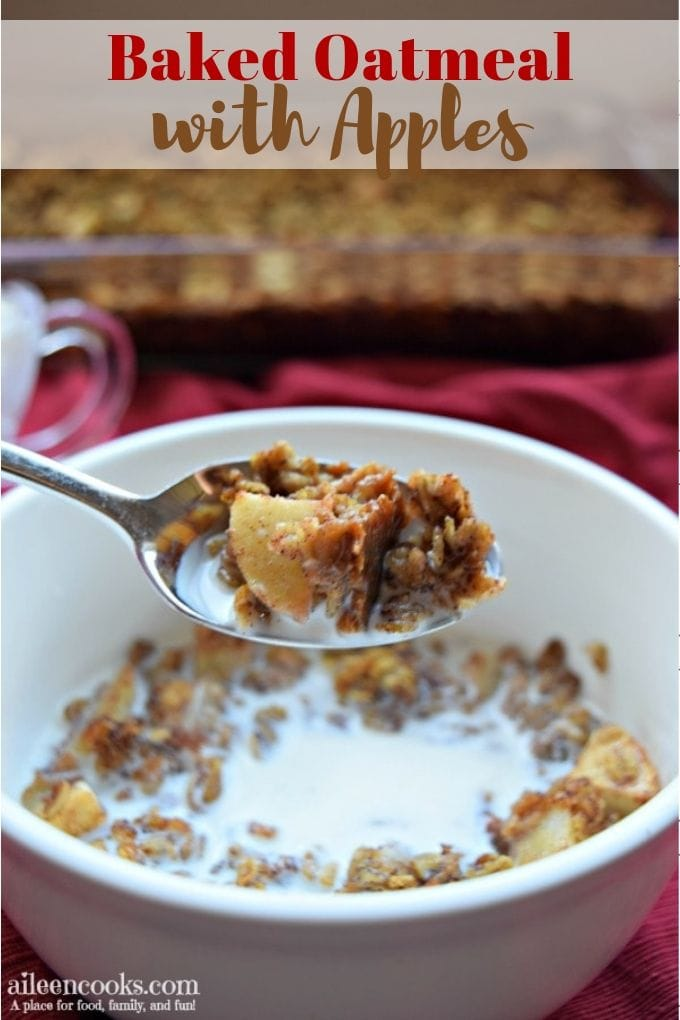 A bowl of baked oatmeal with apples with a bite on a spoon.