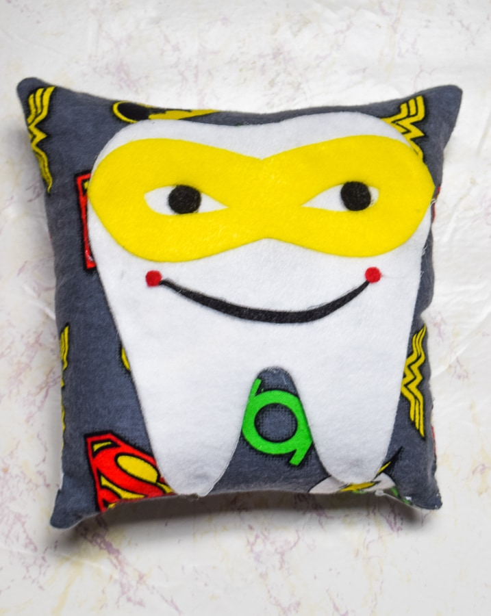 Super Hero DIY Tooth Fairy Pillow with a yellow mask.