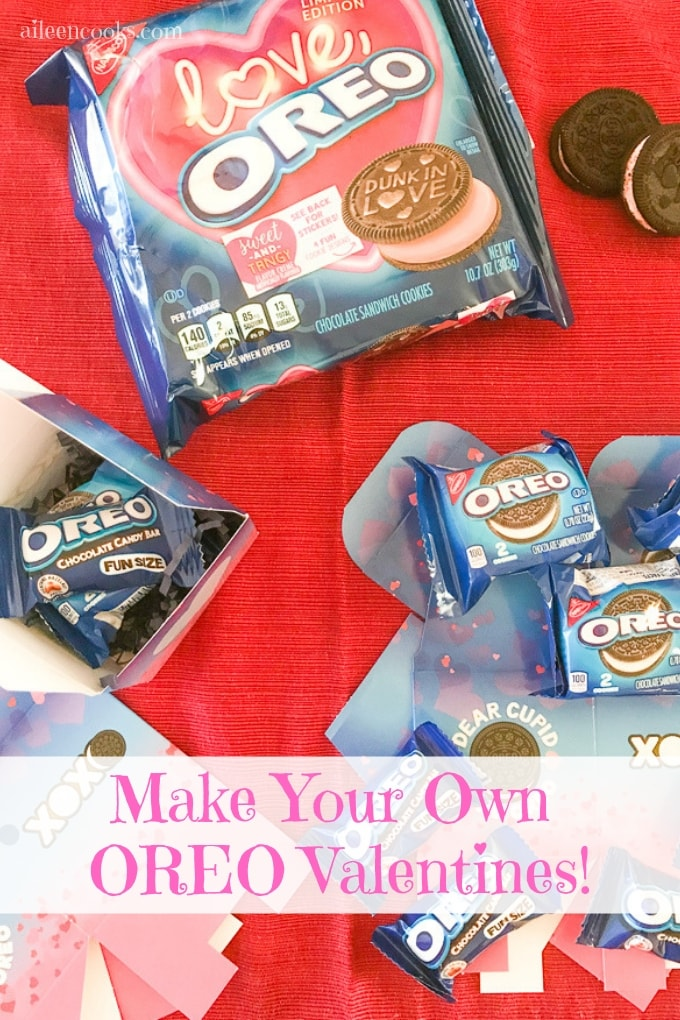 A table with a red tablecloth covered in OREO cookie boxes.