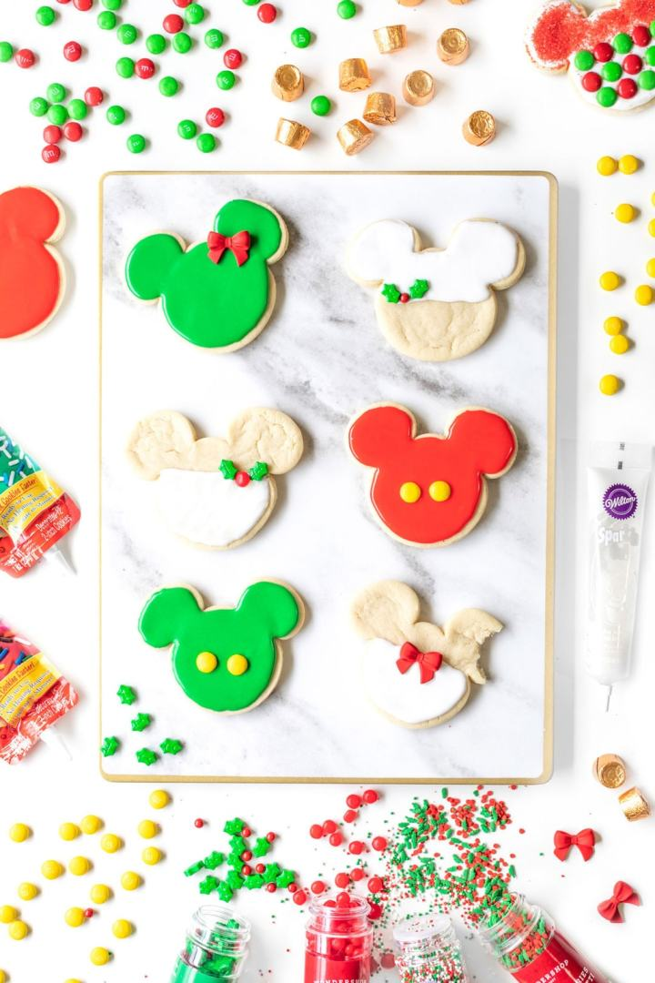 Christmas colored Mickey Mouse cookies.