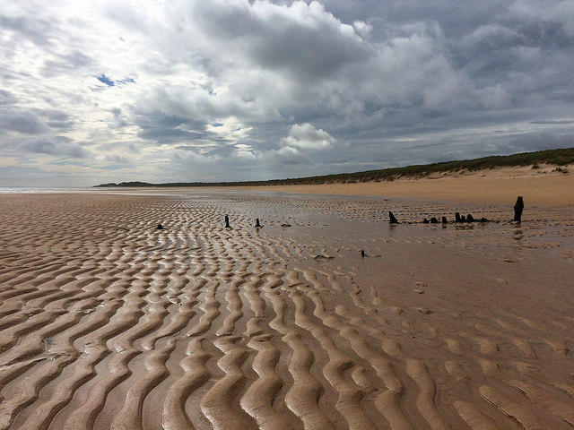 shifting sands uncover a wreck