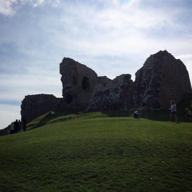 Duffus Castle silhouetted against the sun