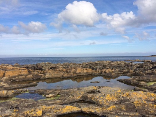 rocky shores and clouds