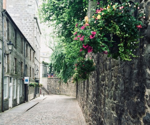 writerly places, a cobbled street with flowers