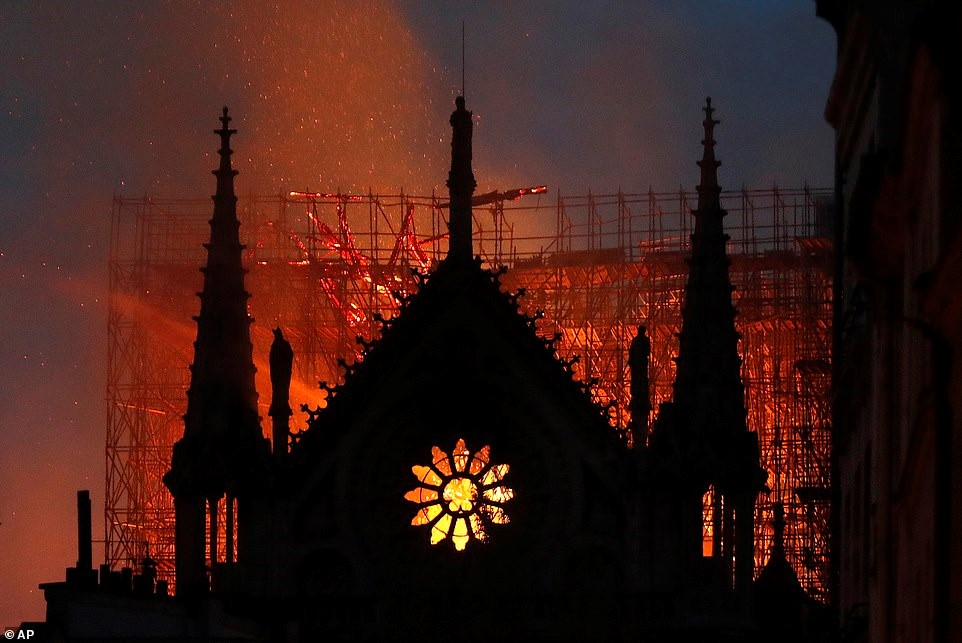 notre dame rose window on fire.jpg