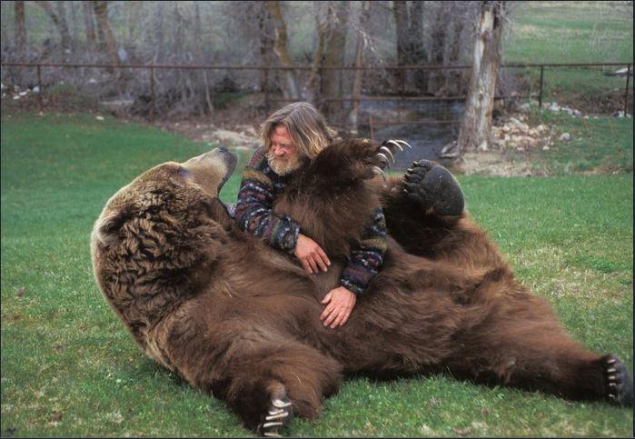 man wrestles bear