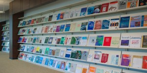 Shelves in a library showing journals where researchers publish a scientific paper.