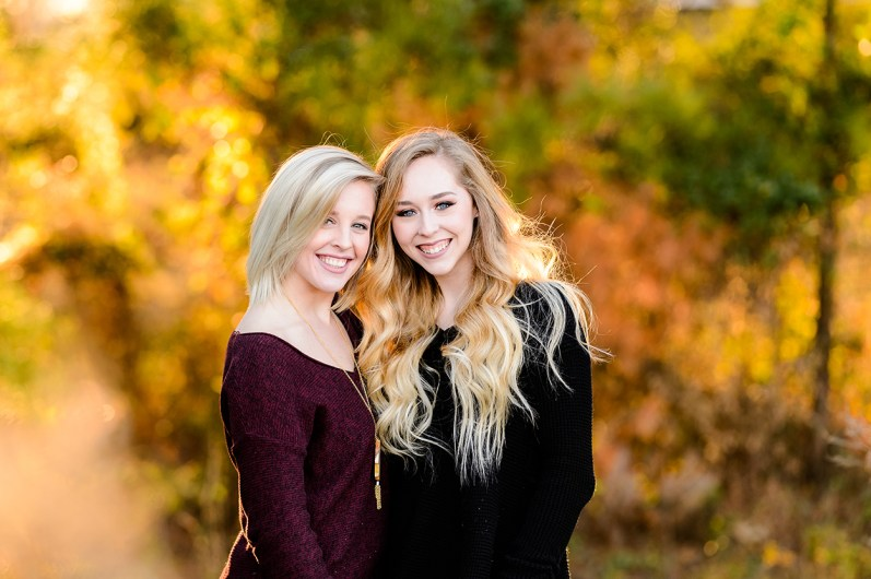 two young senior girls smiling outdoor portrait