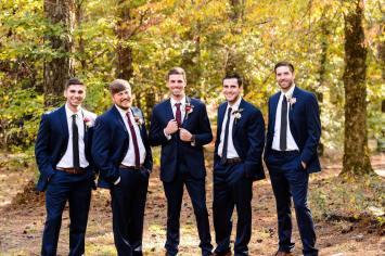 Groom and groomsmen in woods