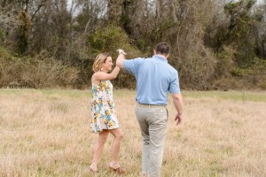 couple dancing in field tryphenas garden middle georgia engagement session