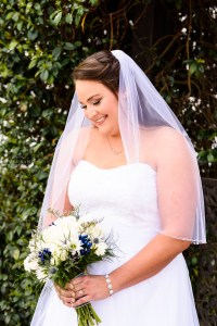 middle georgia wedding, bridal portrait, bride standing holding bouquet in garden