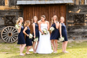 middle georgia wedding, bridal portrait, bridal party standing in front of barn laughing