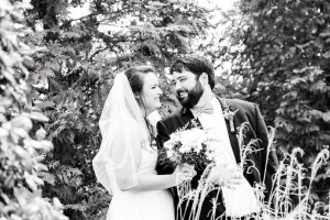 Middle Georgia Wedding, Plantation Farms wedding, bride and groom, wedding day, farm wedding, garden wedding,black and white image of bride and groom standing together bride standing beside groom holding bouquet and looking down, garden wedding portraits