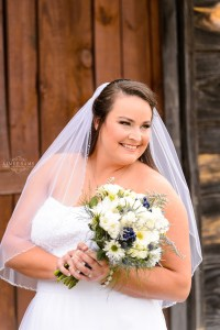 middle georgia wedding, bridal portrait, bride standing holding bouquet in front of barn