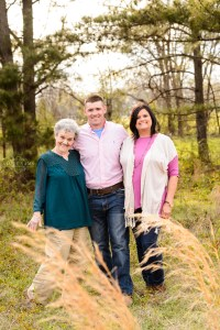 family standing in field in middle georgia for family photography session, sunset pictures