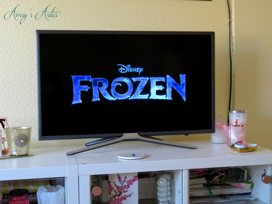 TV screen with the Frozen film title image