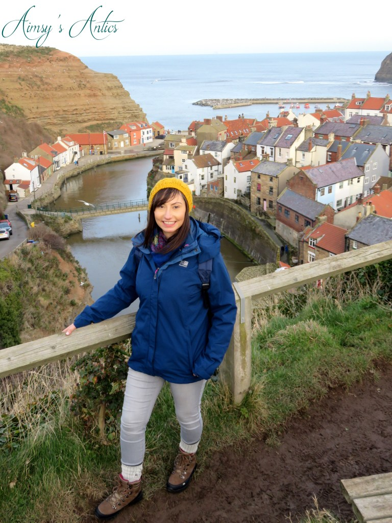 A women standing wit the view overlooking Staithes