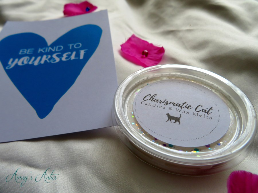 """Charismatic Cat candle melt and inspirational art card with""""Be kind to yourself' written inside a blue heart"""