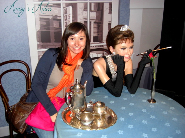 Image of girl posing next to Audrey Hepburn wax work at Madam Tussaud's in London