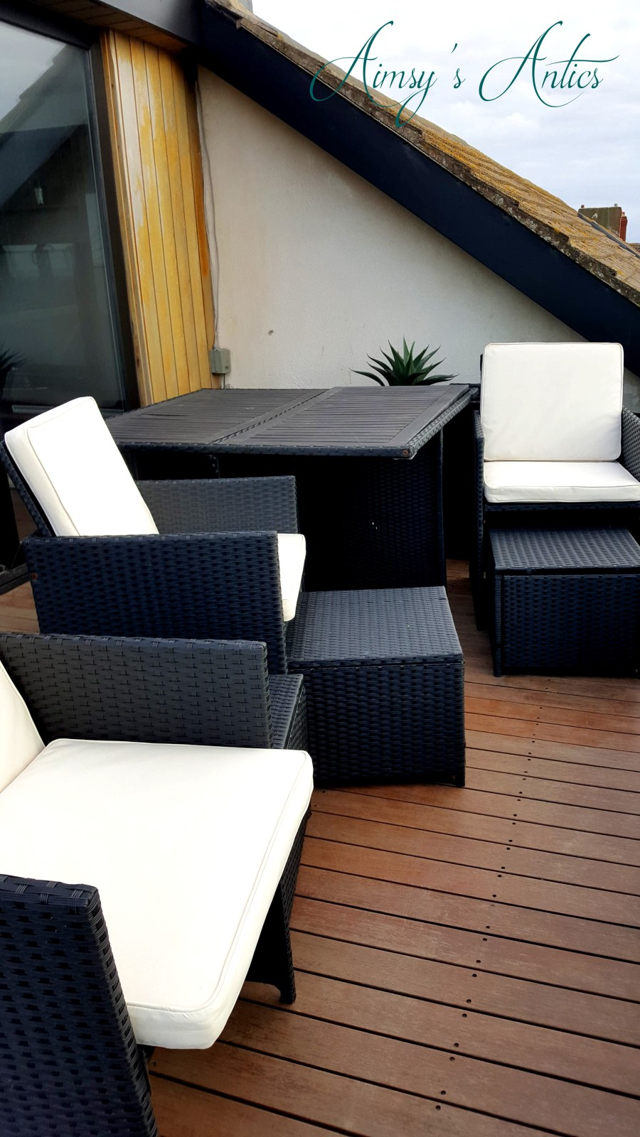 Image of the balcony area at the High-end beachside house with wicker garden furniture