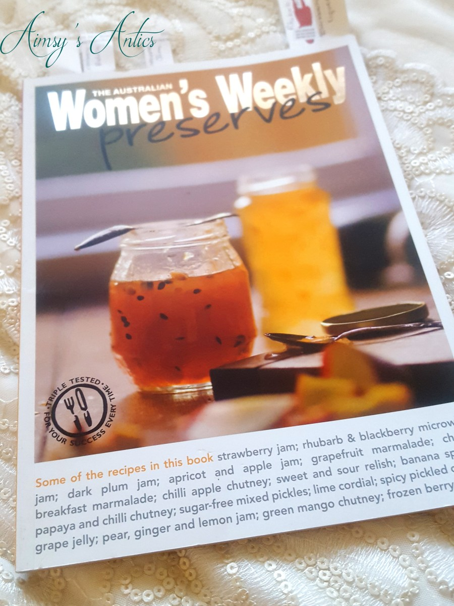 """Image of """"The Australian Women's Weekly preserves"""" recipe book on a sequin background."""