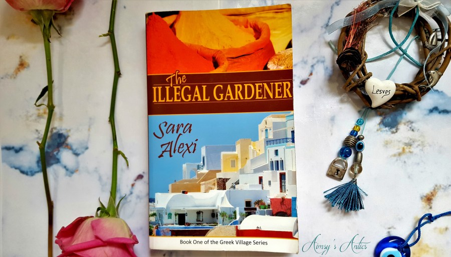 Image of the book 'The Illegal Gardener' by Sara Alexi with various blog photo props, such as roses, a greek eye and a Greek wicker wreath