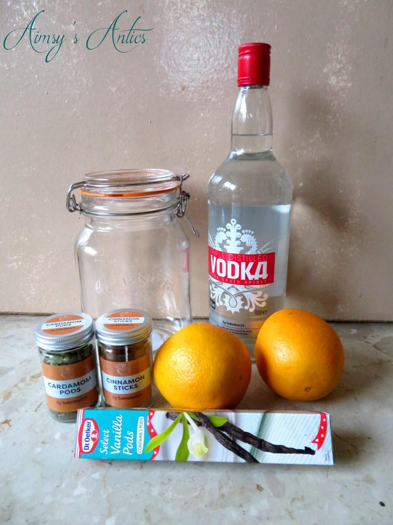Ingredients to make Spiced Arancello. Including vodka, oranges, cinnamon, caradmom and vanilla.