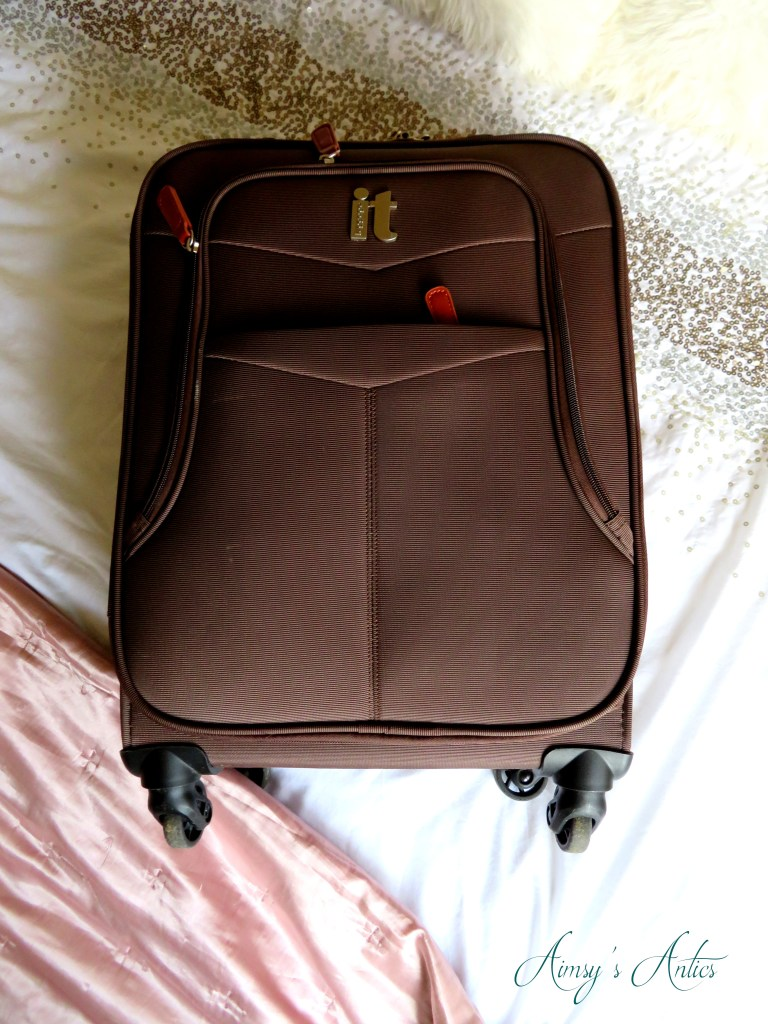 4 wheel 'it' suitcase on a bed.