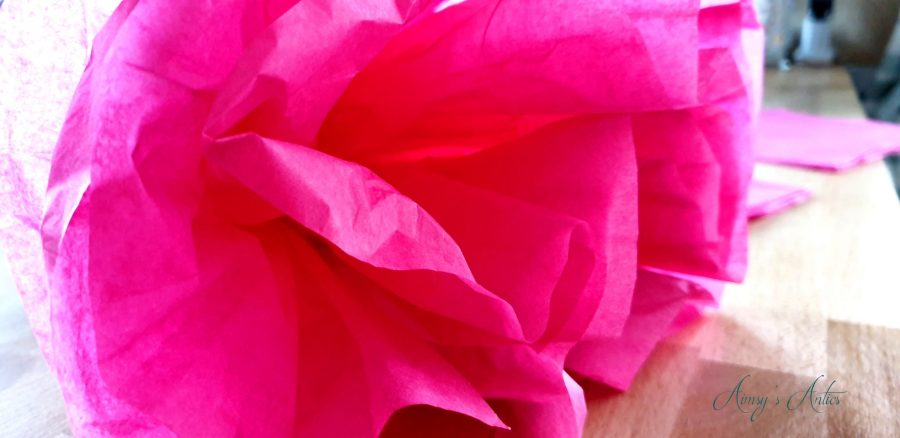 Pink tissue paper in the shape of a flower, close up shot