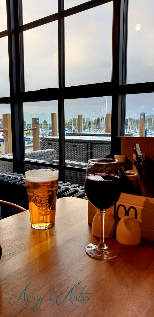 Inside the Mulberry - Pint and glass of wine with the window in the background showing the marina