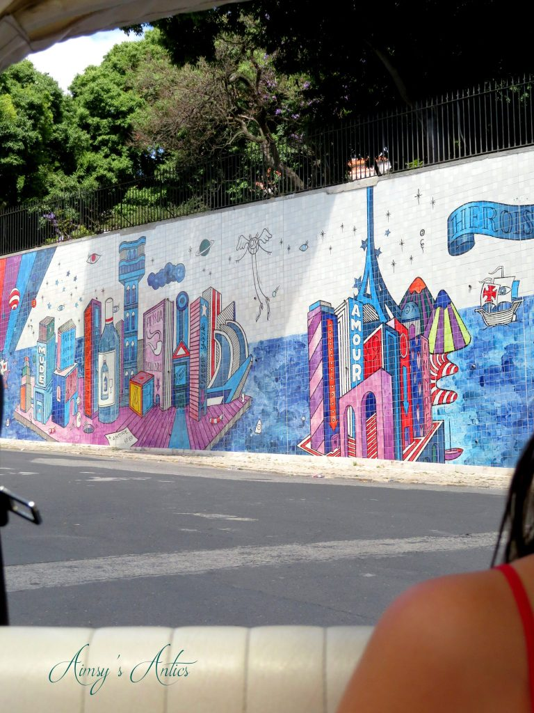 View of André Saraiva Mural from the back of a tuk-tuk in Lisbon
