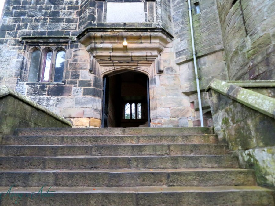 Steps leading up to an entrance of Skipton Castle.