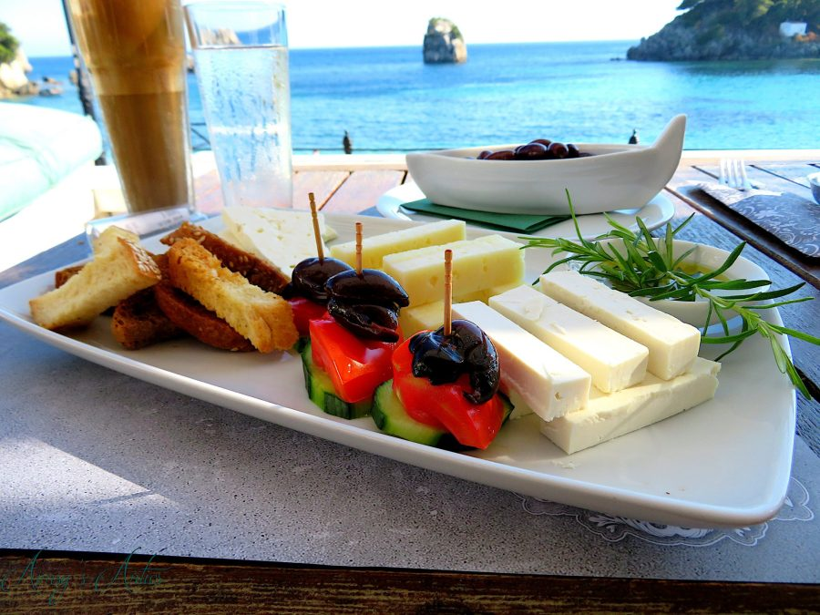 Greek chees platter with cucumber, tomato and olives