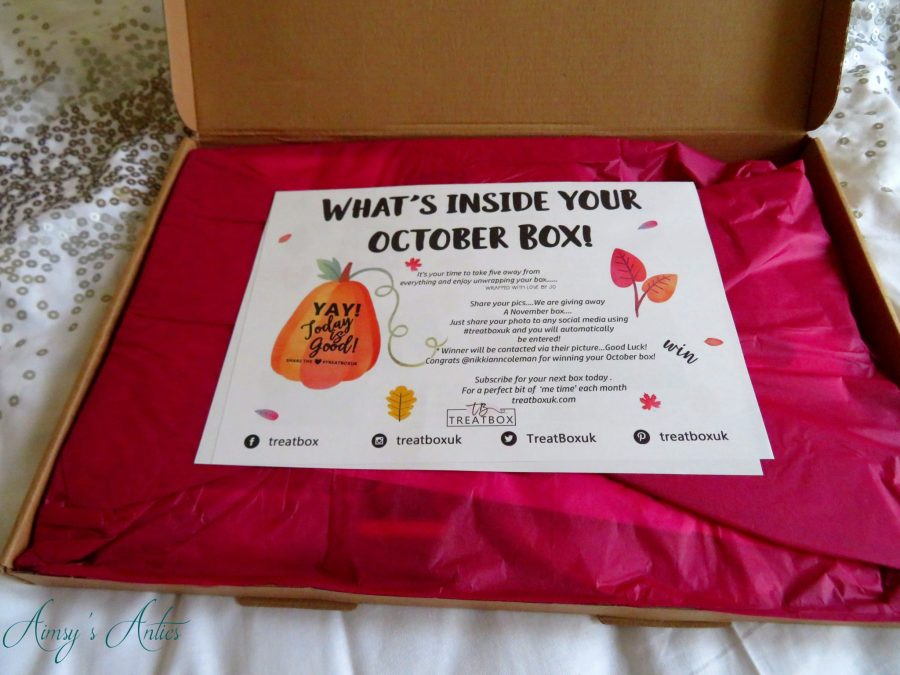Inside the treatbox with a card detailing the contents