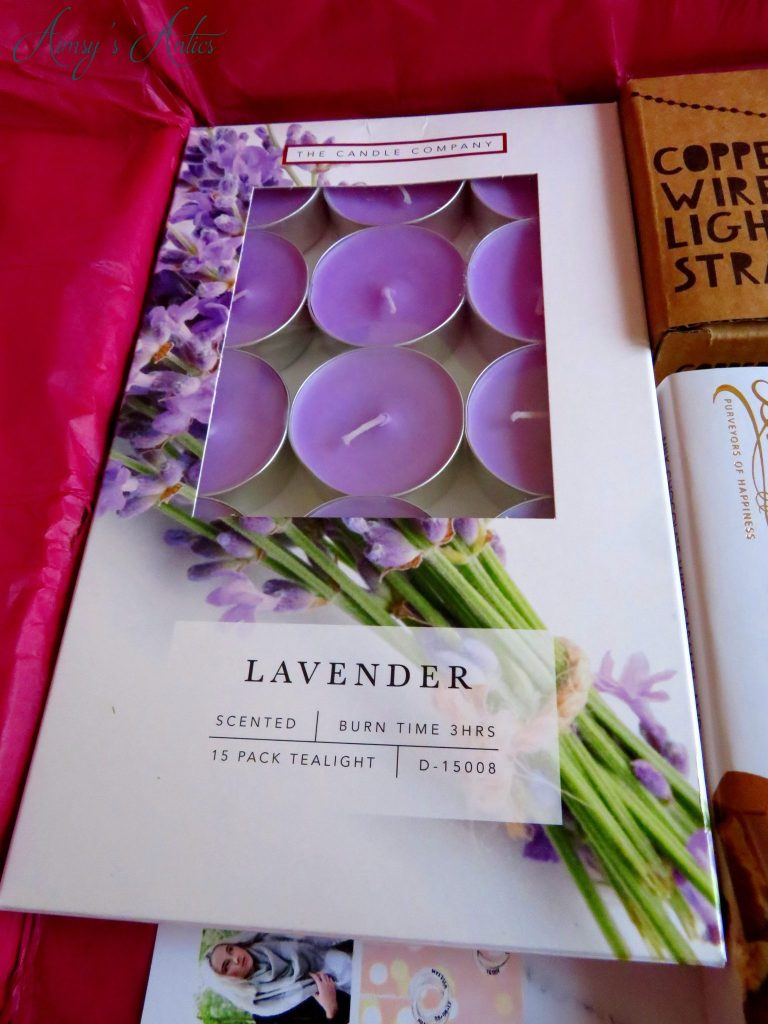 A box of lavender scented tealight candles