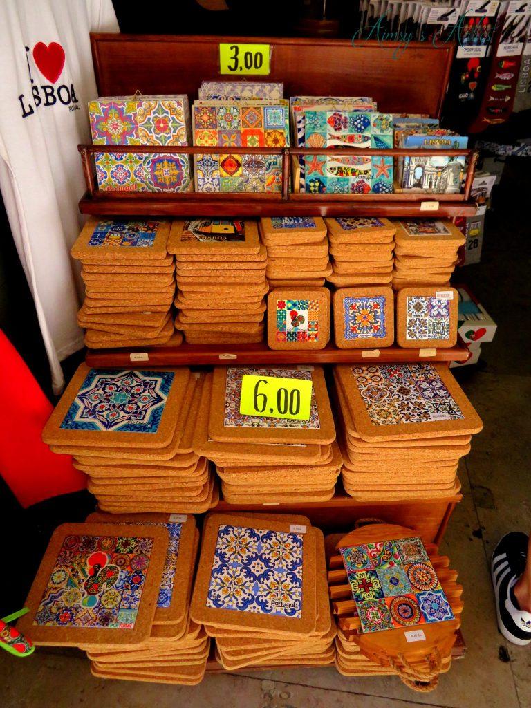 Decorative Portuguese tiles as coasters in a shop in Lisbon