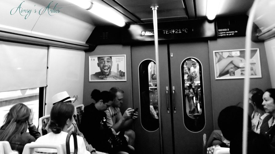 People sat on a train to Sintra