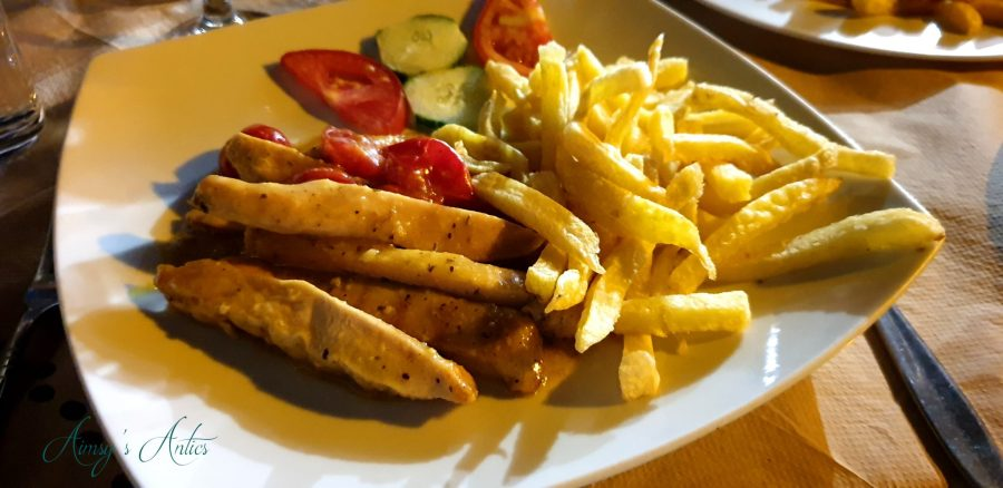 Orange and ouzo chicken with salad and chips