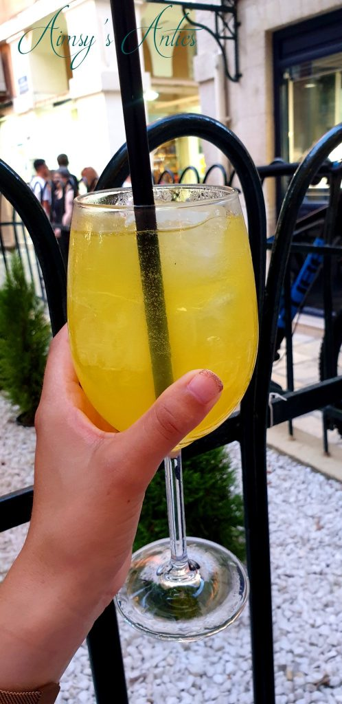 Limoncello Spritz in a glass being held up