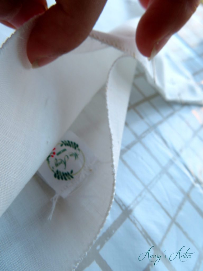 Adding a label into the side seam of the cushion