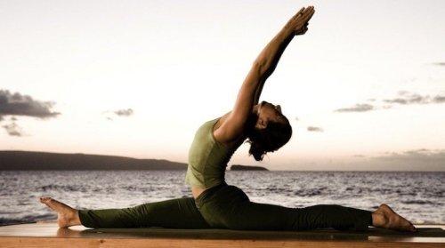 Iyengar yoga pose near the beach