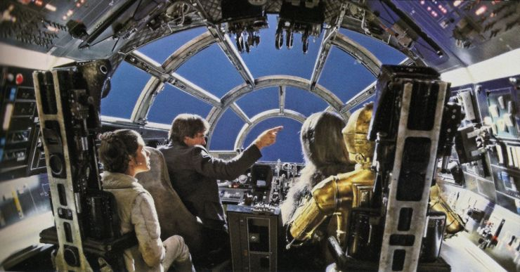 View from the back of the Millennium Falcon cockpit set with the back removed for camera placement to shoot the set and actors against a blue screen to be filled with space environments in post-production. © Lucasfilm Ltd. and TM. All Rights Reserved.