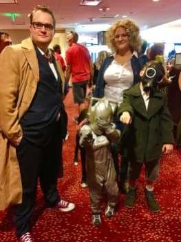 The family that cosplays together, stays together. Doctor, River Song, tiny Cyberman, and Are You My Mummy from Doctor Who.
