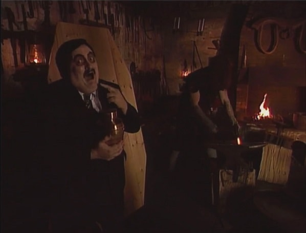 Undertaker Building A Casket With Paul Bearer