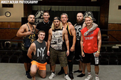 (From left to right) Marty Scurll, Will Ospreay, Zack Sabre Jr., Mark Haskins, Pete Dunne, Tommy End, and Mark Andrews at PWG's BOLA 2016 event.