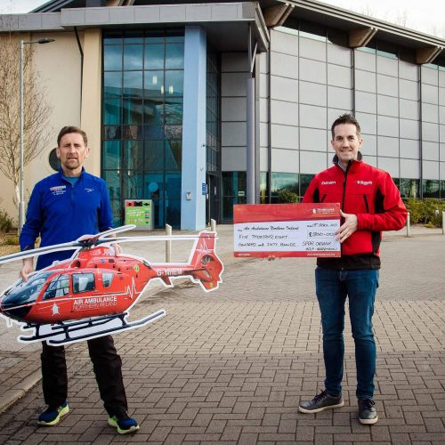Martin McLaughlin from the Spar Omagh Half Marathon committee presents £5,860 to Damien McAnespie, Air Ambulance NI Charity Fundraising Manager, from registration payments that were deferred from last year's race to this year's cancelled 2021 event.