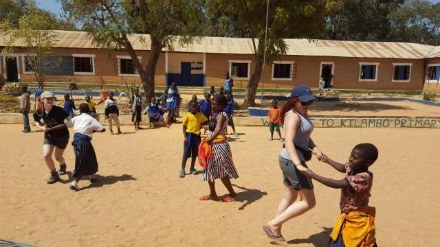 Me dancing with primary school kids in Kilambo Primary, Tanzania